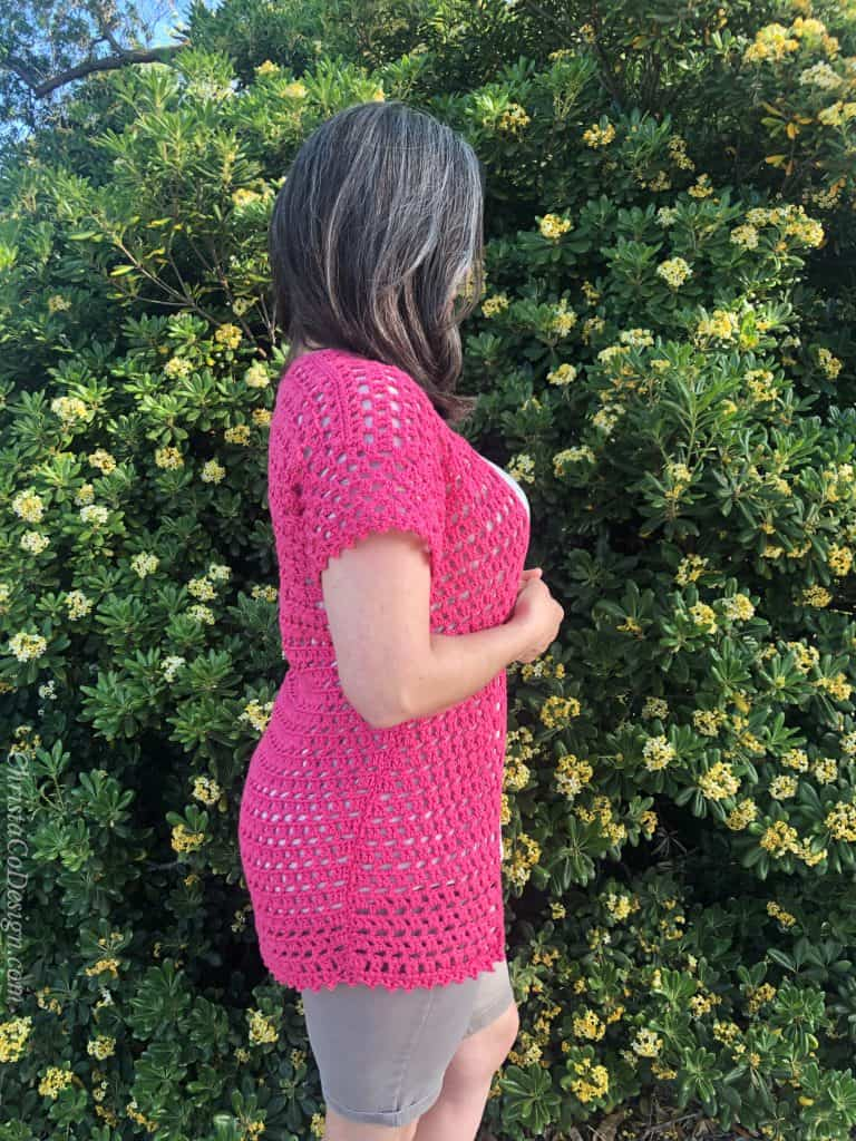 Side view of pink lacy summer cardigan crochet pattern.