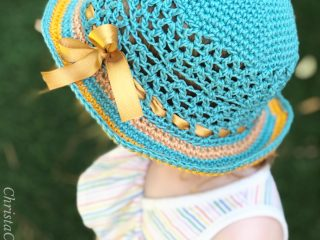 Top down crochet brimmed hat on girl.