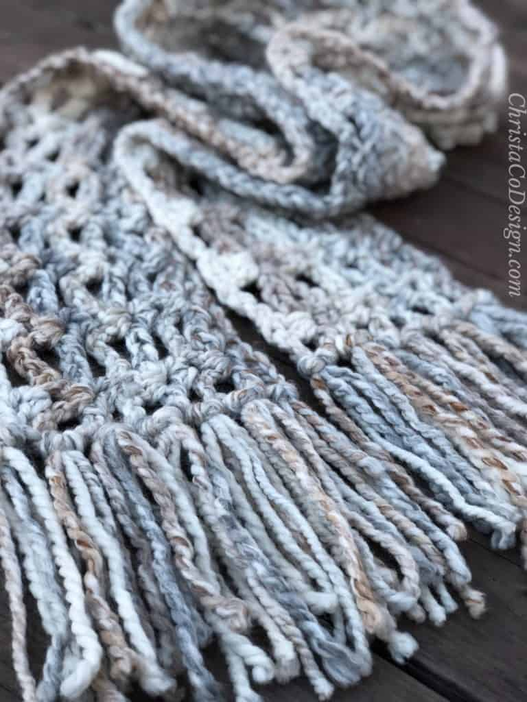 Chunky crochet scarf with fringe.