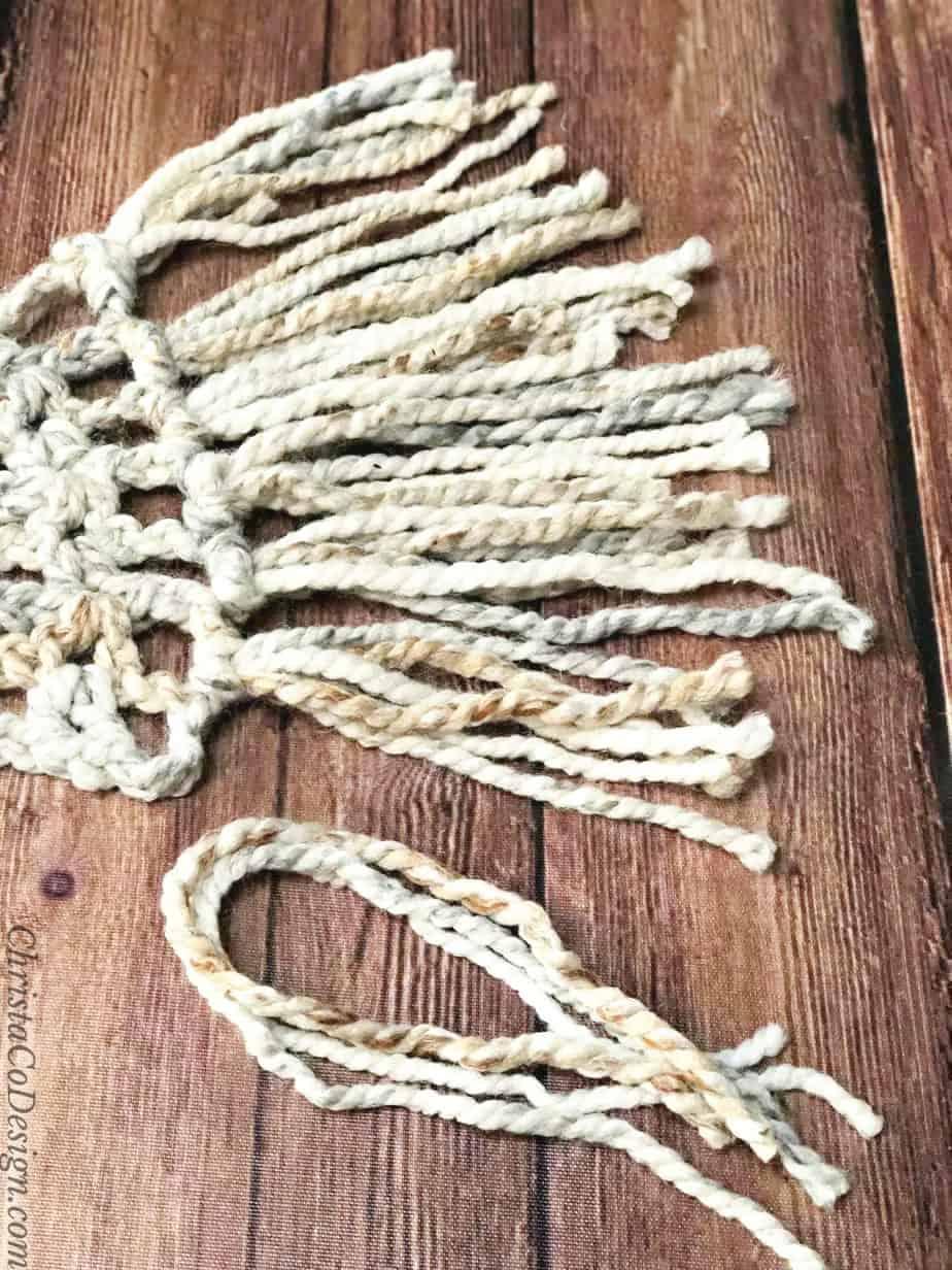 Fringe on end of scarf.