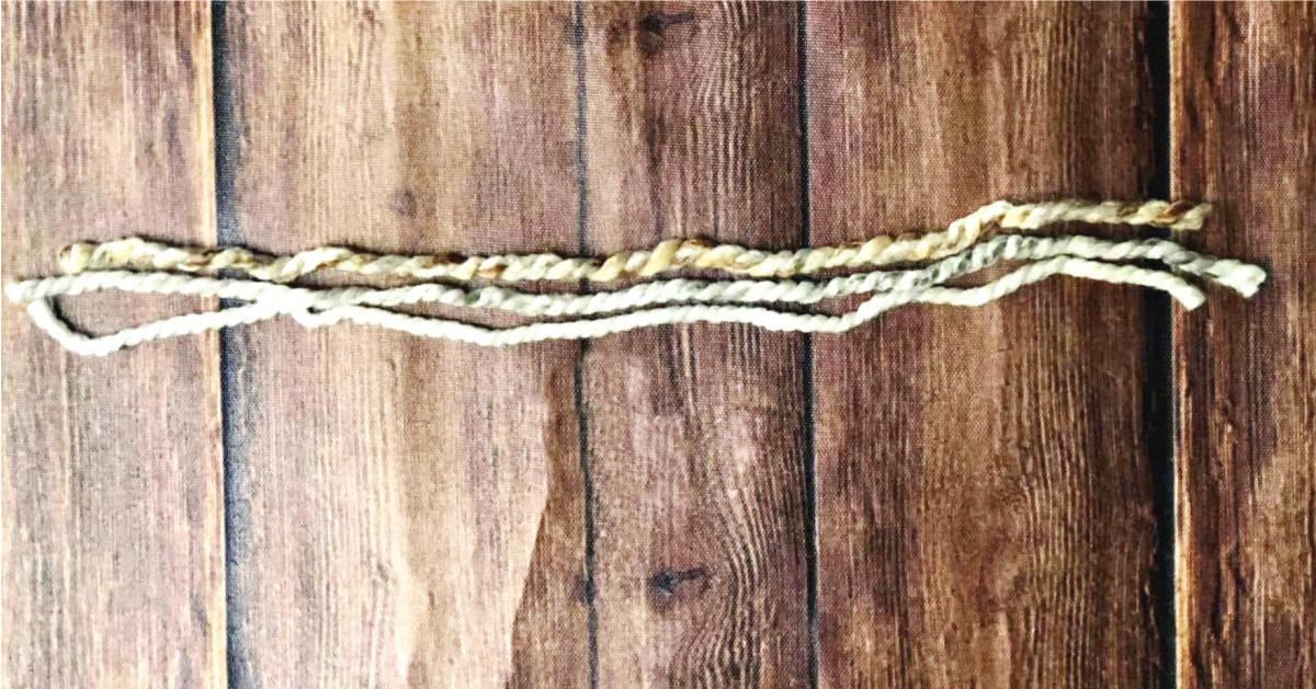 3 lengths of yarn for fringe tutorial.
