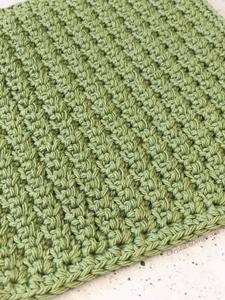 Close up of textured stitch on dishcloth.