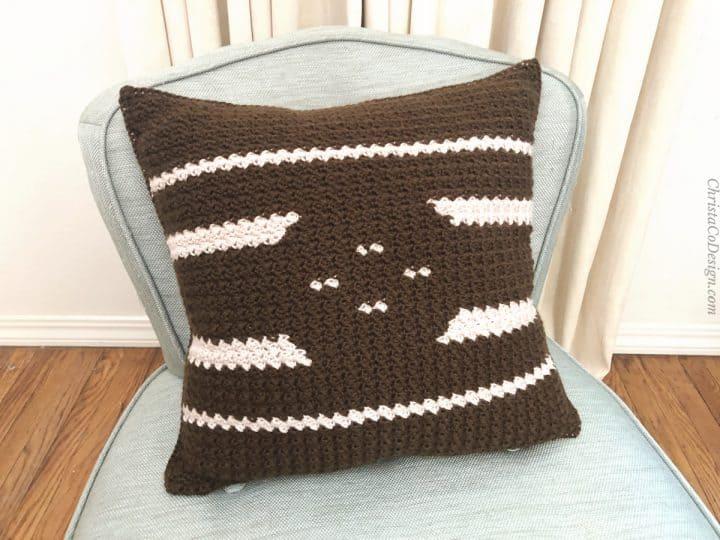 Close up of dark side crochet pillow.