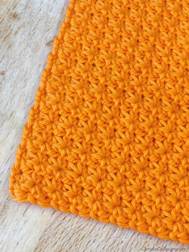 Crochet dishcloth with texture close up of the corner.