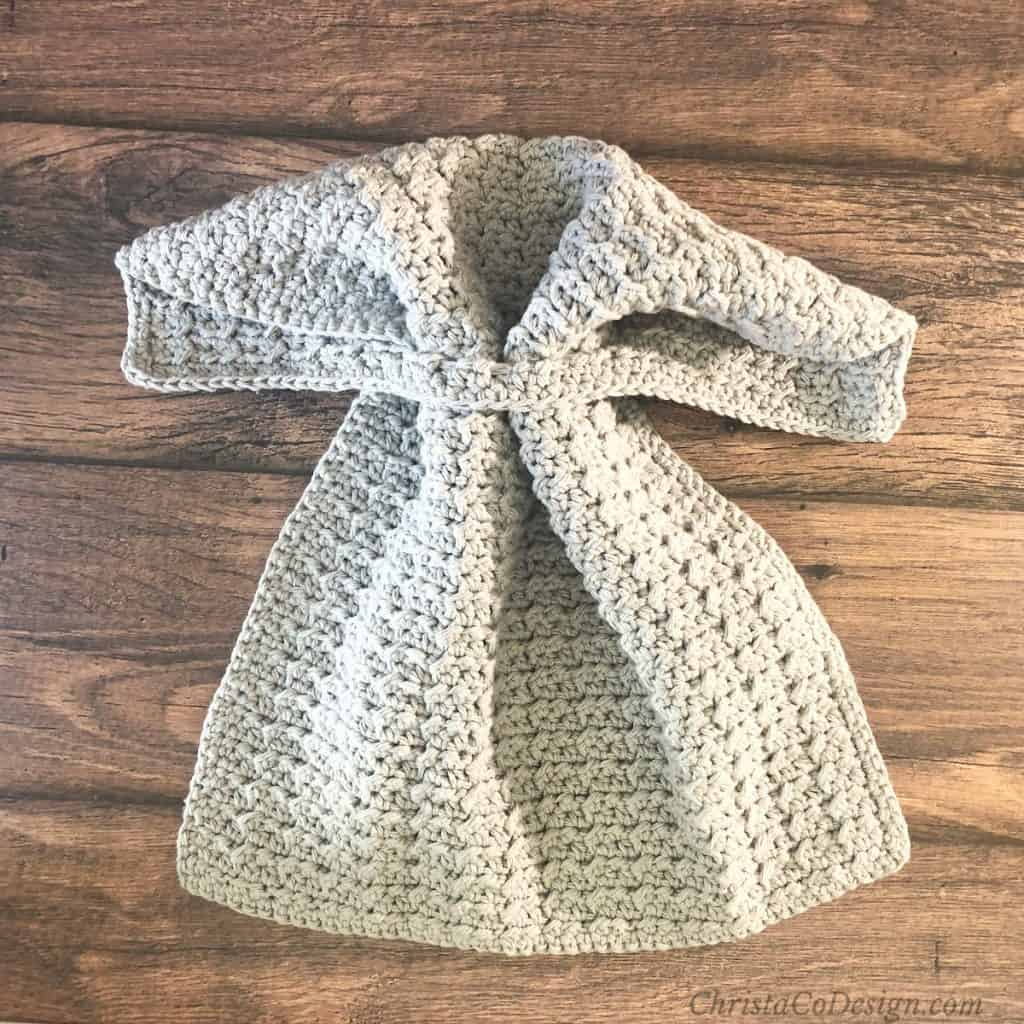 Crochet kitchen towel pattern in grey threaded through for hanging.