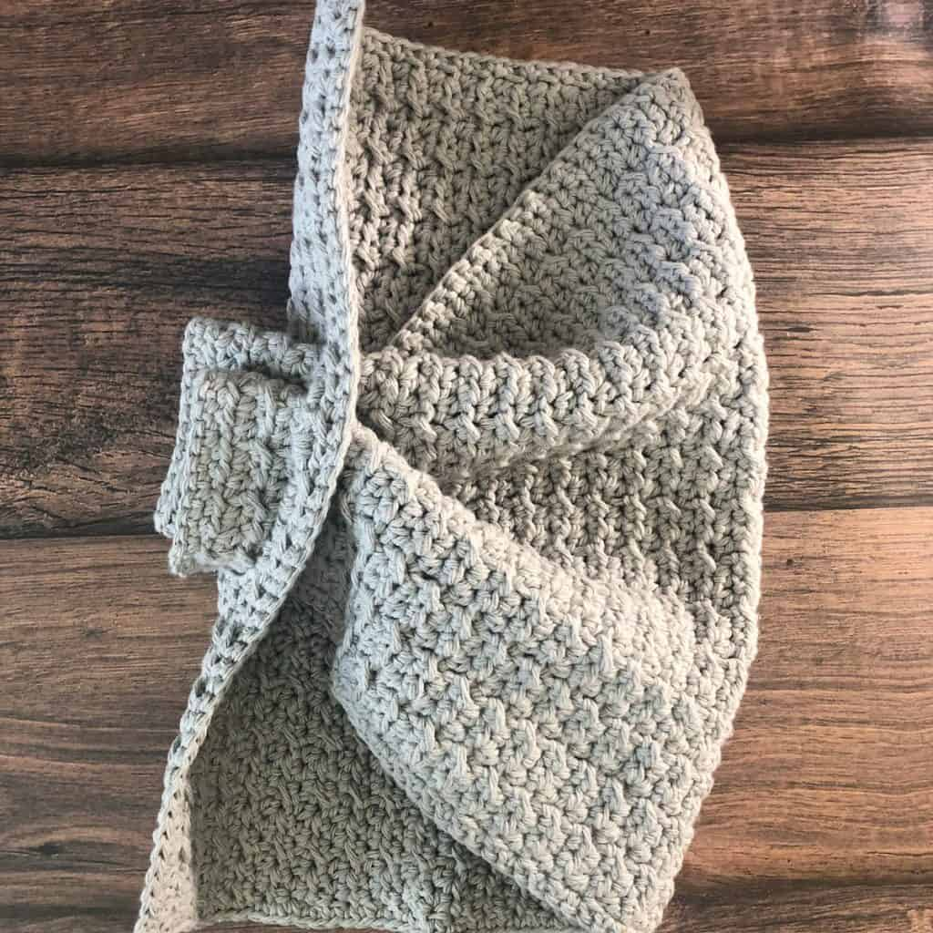 Thread end of crochet kitchen towel pattern through for hanging.