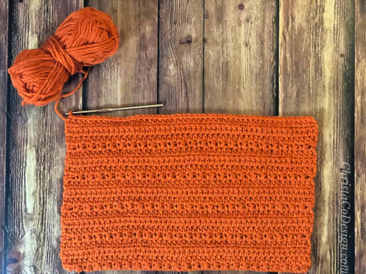 Crochet rectangle ready for seaming on crochet pixie hat pattern.