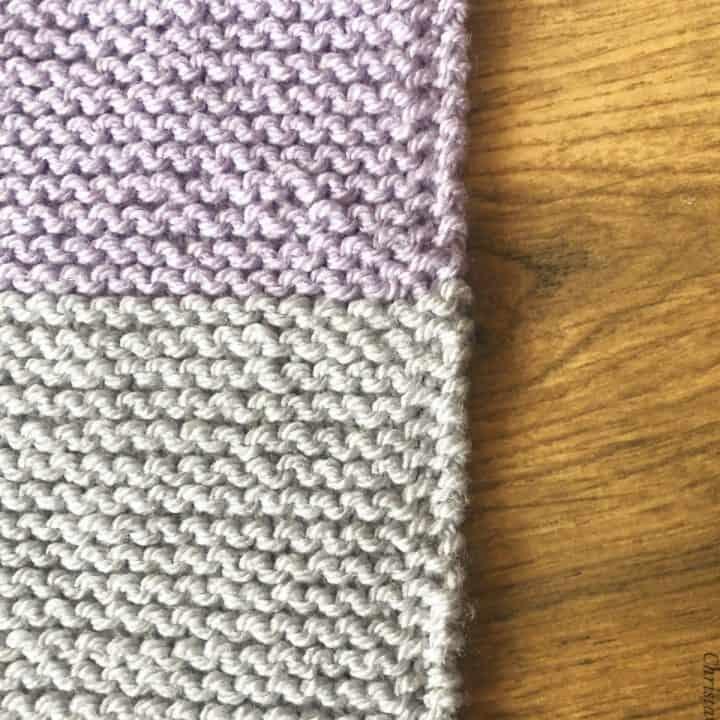 Slip 1 edge in garter stitch purple and grey blanket.