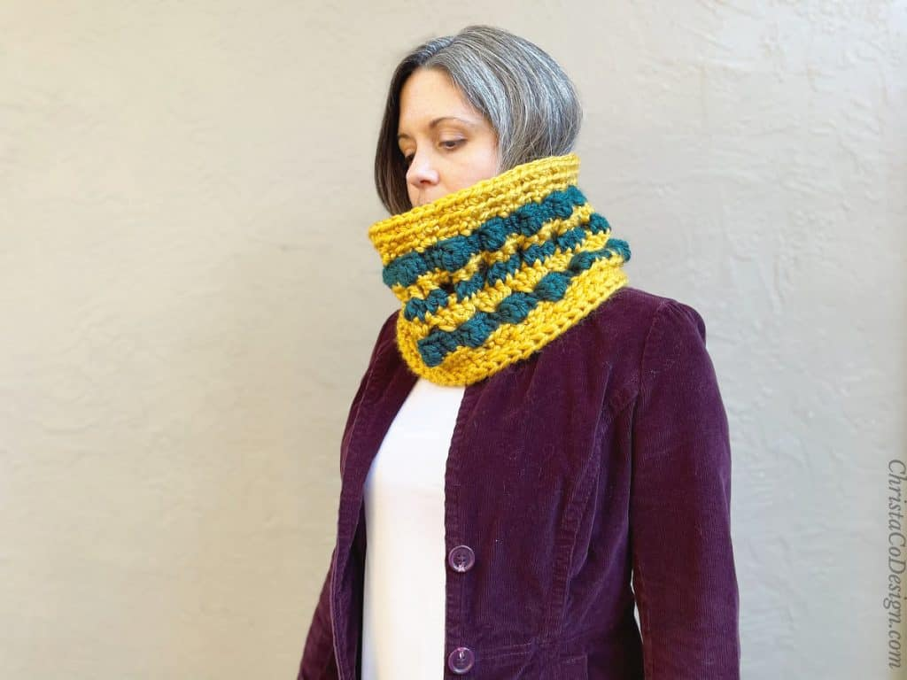 Chunky crochet cowl pattern with stripes and color.