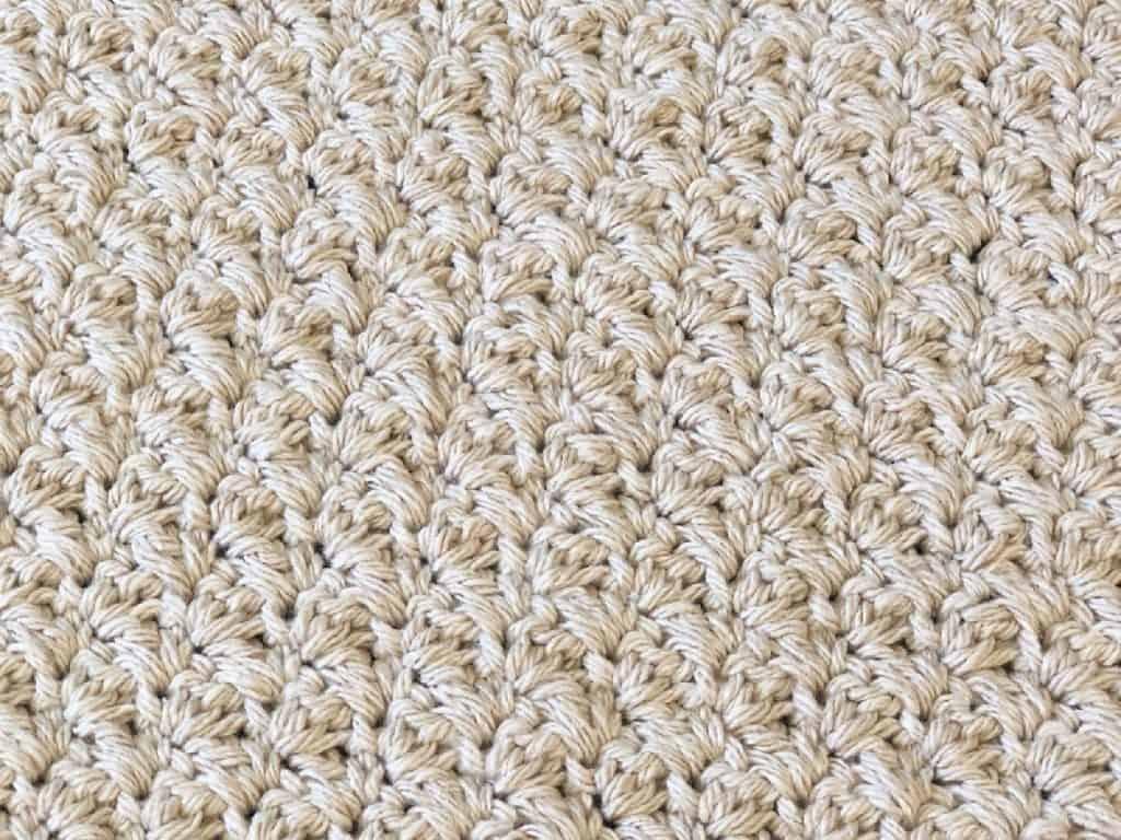 Crochet grit stitch in beige cotton yarn, close up.
