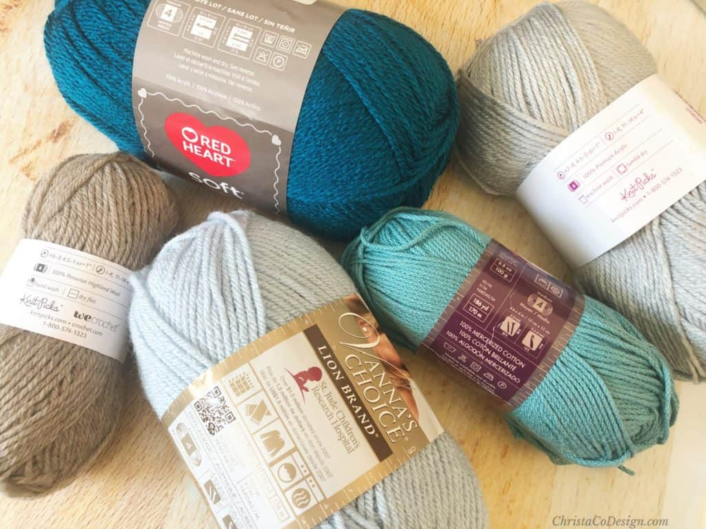 Yarn skeins with labels on in a variety of colors.
