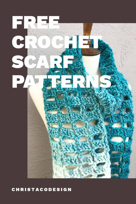 Chunky teal crochet scarf on mannequin.