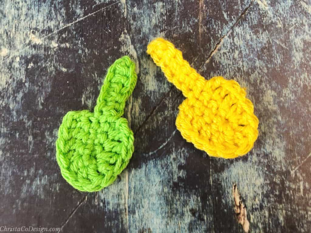 Green and yellow crochet leaf with stem.