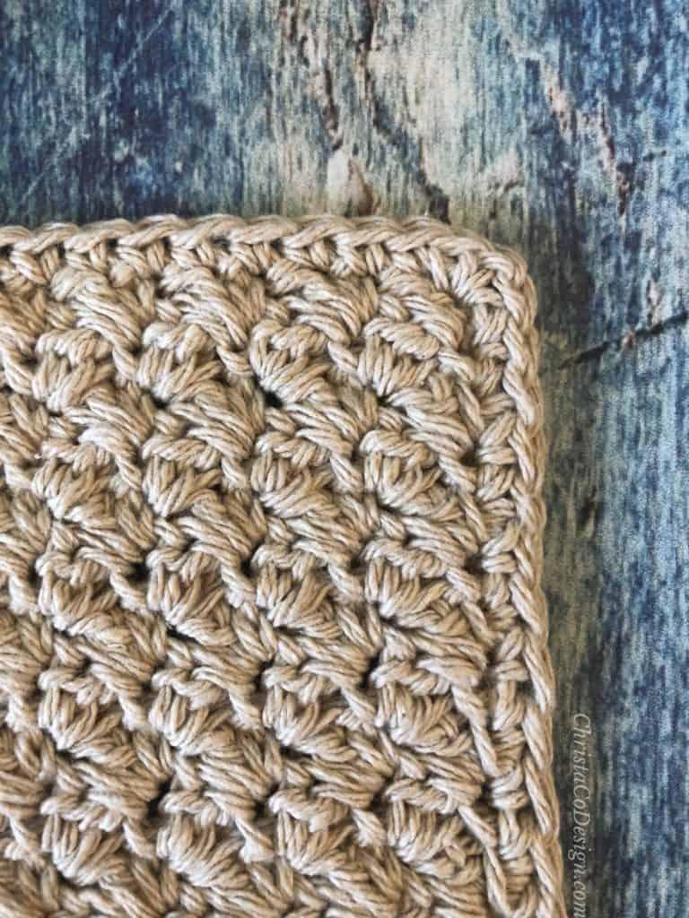 Edges of washcloth in single crochet.