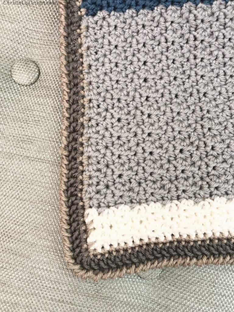 Corner and crab stitch border on crochet blanket.