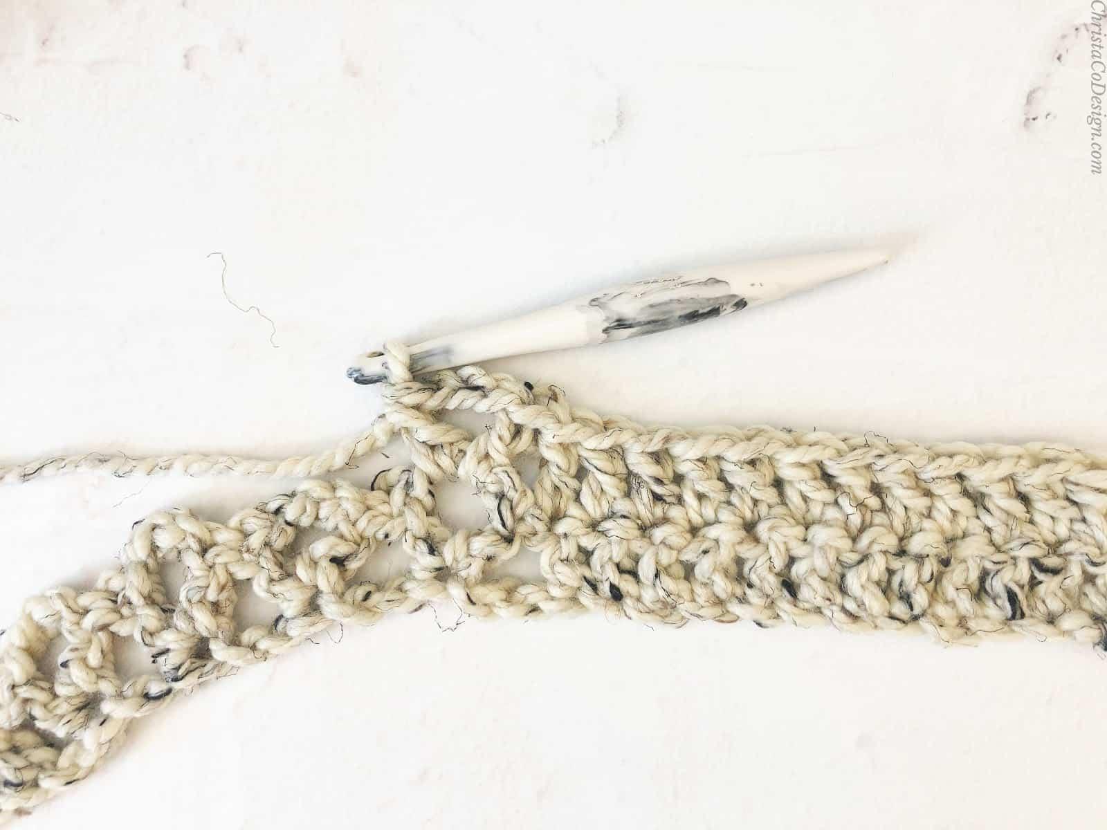 Row 2 double crochet to v-stitch center.