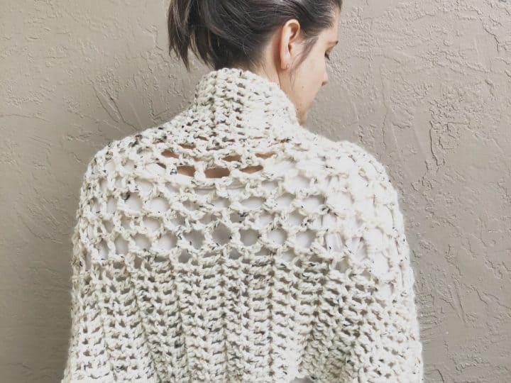 Back view of cozy rectangle shawl crochet pattern in cream yarn.